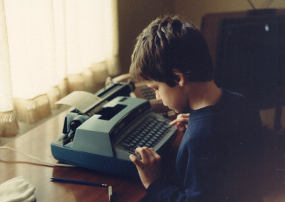 The young me and the noisiest typewriter on earth. Lordy, did I love it.
