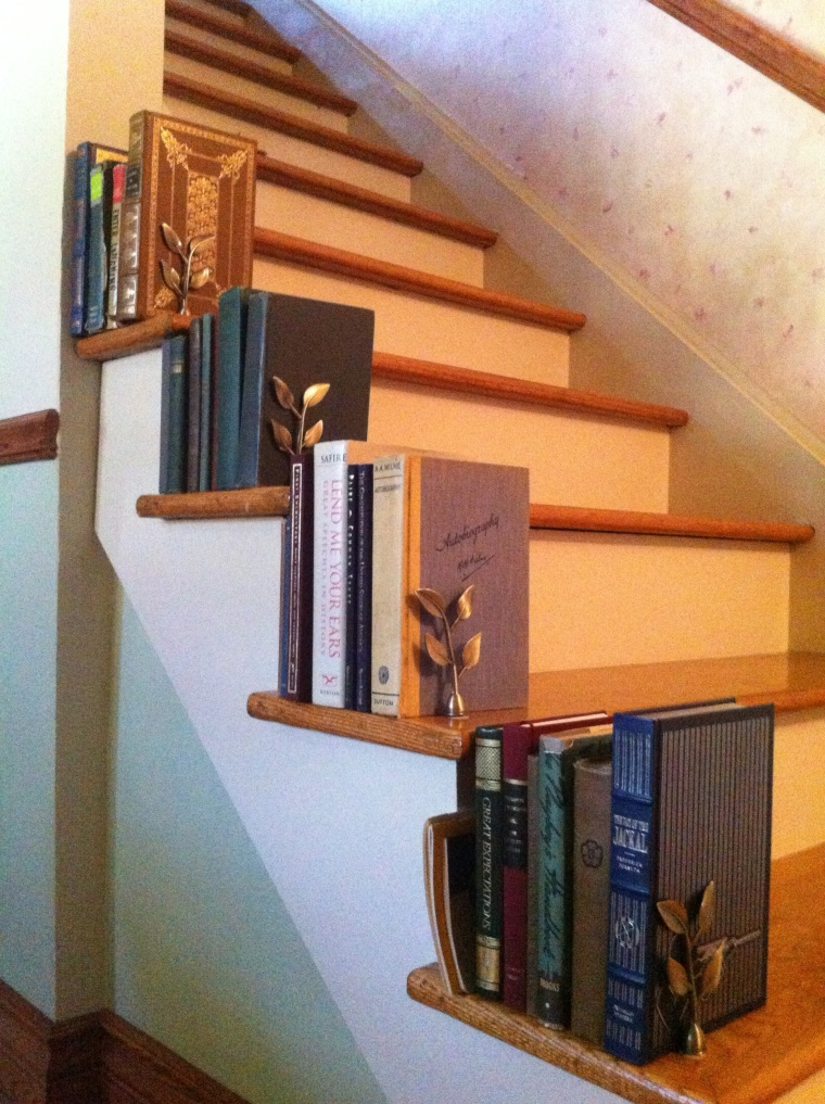 Who needs a bannister when you can make bookshelves? Seriously.